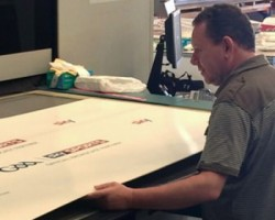 Paul with the NUR Tempo II 3.2m UV flatbed printer