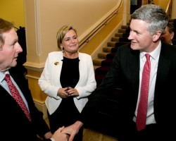 An Taoiseach, Enda Kenny TD, is greeted by Dr Adrian Howd, CEO of Malin with Deirdre Somers, CEO, Irish Stock Exchange at the launch of the Malin IPO at the Irish Stock Exchange