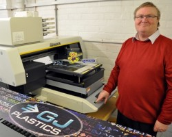 G J Plastics' owner Graham Croston with the company's new Mimaki UJF-3042