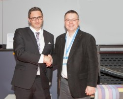 From L to R at the signing on the Durst stand at FESPA Digital - Christoph Gamper CEO of the Durst Group, and Richard Leach