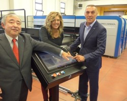 Mrs. Elena Daddi, Bregnano Town Mayor, pushes the button to officially launch the new €5m textile innovation centre at Como flanked by Konica Minolta's Akiyoshi Ohno (left) and Enrico Verga