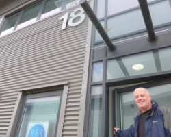 John Corrall outside the new building
