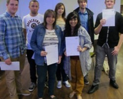 Walsall College Graphic Design students proudly holding their certificates