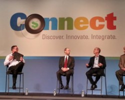 During a panel session at the recent EFI Connect conference, Hardwire CEO George Tunis (second from right) and EFI's Frank Mallozzi (far left) discuss a bulletproof Hardwire clipboard that features graphics  printed on Tunis's new EFI VUTEk QS2 Pro UV-inkjet printer.