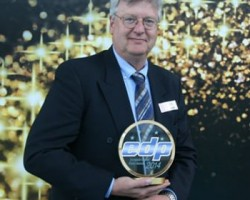 Mimaki EMEA's Mike Horsten with one of the company's two EDP Awards