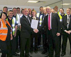 Mike James, LRQA (left) presenting the OHSAS 18001 certificate to David Hunter - Managing Director, Antalis UK (right) and the Antalis team.