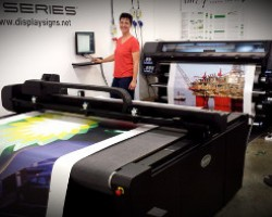 Senior designer Daniela Phillips testing out some wall vinyl prints, being produced on the HP Latex 360 and the Summa F Series Cutter