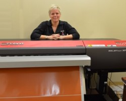 Tracey Shanks partner at Mercury Signs and Designs and the high speed Roland beast